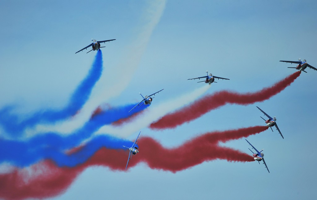 . Alpha jets, part of the Patrouille Acrobatique de France, leave trails of smoke in the colours of the French national flag during an international D-Day commemoration ceremony on the beach of Ouistreham, Normandy, on June 6, 2014, marking the 70th anniversary of the World War II Allied landings in Normandy.  AFP PHOTO / GUILLAUME  SOUVANT/AFP/Getty Images