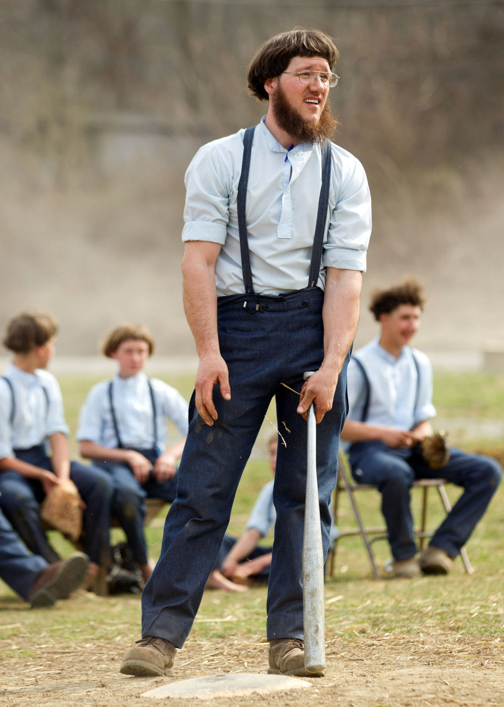 Description of . Freeman Burkholder waits for his at bat during a game of baseball at the farewell picnic in Bergholz, Ohio on Tuesday, April 9, 2013.  The picnic was for Burkholder and other Amish people leaving for prison this week for their part in the hair and beard cutting scandal against other Amish members.  (AP Photo/Scott R. Galvin)