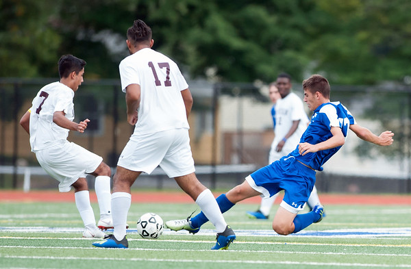 09/17/18 Wesley Bunnell | Staff Bristol Eastern soccer defeated New Britain 2-0 on Monday afternoon at Bristol Eastern High School. New Britain's Brandon Tobon (7), Nolber Gonzalez (17) and Bristol Eastern's Ben Chiasson (17).