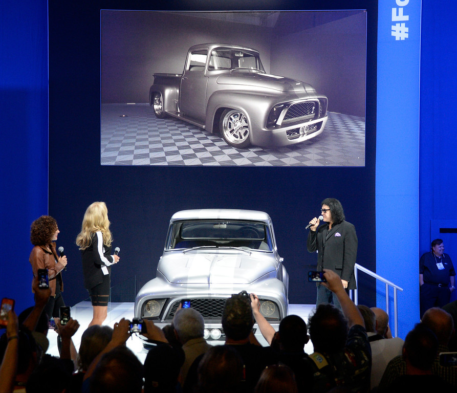 . Nov 5,2013 Las Vegas NV. USA. KISS front man Gene Simmons and his wife, Shannon introduce their customized 1956 F-100 pickup, to be auctioned off for charity in Jan 2014 at the 2014 Barrett-Jackson Auction in AZ,  during the first day of the 2013 SEMA auto show.