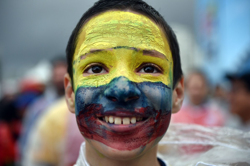 . A Colombia fan is pictured during the Fanfesta public viewing event at Copacabana beach in Rio de Janeiro of the Group C football match between Colombia and Ivory Coast of the 2014 FIFA World Cup on June 19, 2014.     AFP PHOTO / YASUYOSHI  CHIBA/AFP/Getty Images