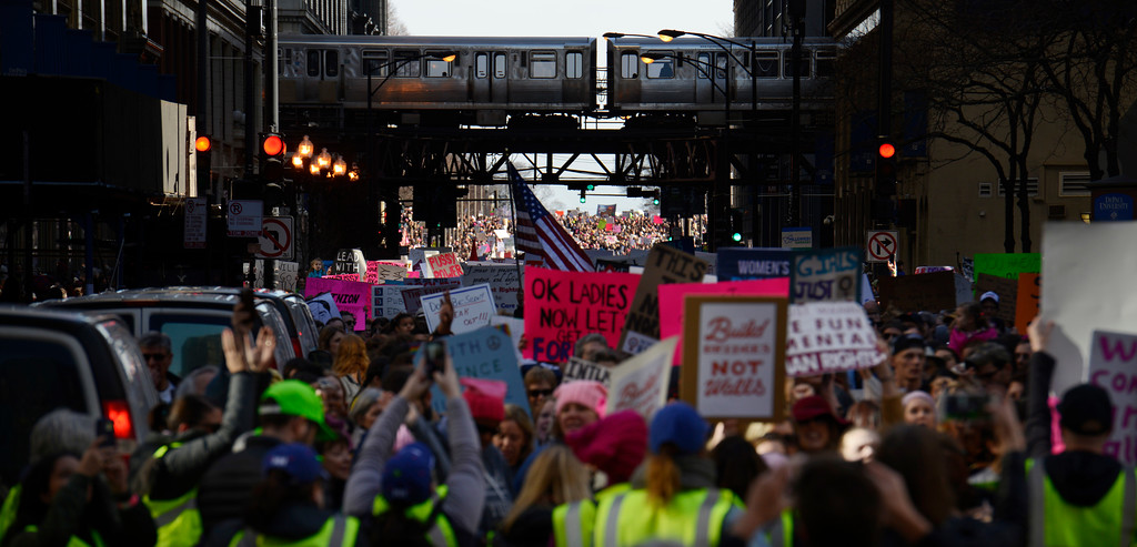 . Protesters protest newly inaugurated President Donald Trump during a women\'s march Saturday, Jan. 21, 2017, in Chicago. (AP Photo/Paul Beaty)