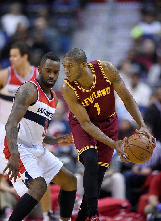. Cleveland Cavaliers forward James Jones (1)handles the ball against Washington Wizards forward Martell Webster (9) during the second half of an NBA basketball game, Friday, Feb. 20, 2015, in Washington. The Cavaliers won 127-89. (AP Photo/Nick Wass)