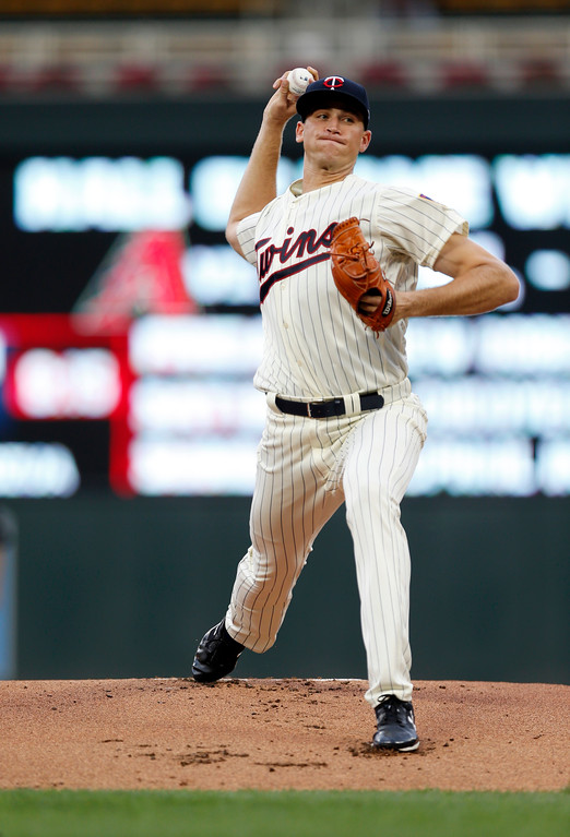 . Minnesota Twins pitcher Aaron Slegers, making his major league debut, throws against the Cleveland Indians in the first inning of the second game of a baseball doubleheader Thursday, Aug. 17, 2017, in Minneapolis. (AP Photo/Jim Mone)