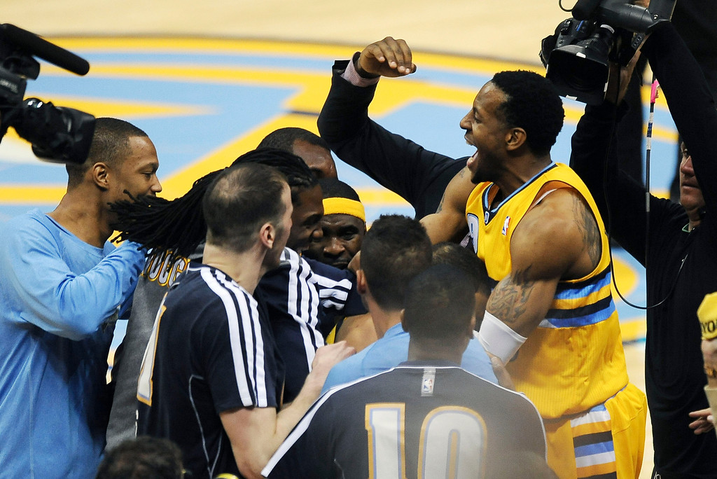 . DENVER, CO. - APRIL 20: Denver Nuggets mob Andre Miller after he hit the game-winning shot in the fourth quarter against Golden State. The Denver Nuggets defeated the Golden State Warriors 97-95 in Game 1 of the Western Conference First Round Series at the Pepsi Center in Denver, Colo. on April 20, 2013. (Photo by Steve Nehf/The Denver Post)