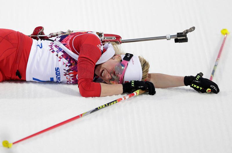 . Switzerland\'s Elisa Gasparin catches her breath after finishing the women\'s 15K individual biathlon race at the 2014 Winter Olympics, Friday, Feb. 14, 2014, in Krasnaya Polyana, Russia. (AP Photo/Matthias Schrader)