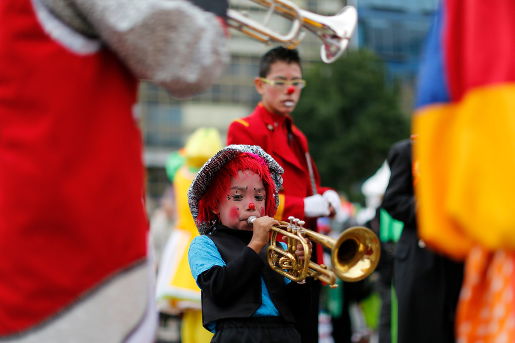 . A young clown blows on a trumpet while performing with other clowns on the third day of the 17th International Clown Convention in Mexico City, Wednesday, Oct. 23, 2013.  Clowns from Latin America gathered in Mexico\'s capital to enter competitions, exchange experiences and take workshops in order to brush up on their clown techniques and learn new tricks. (AP Photo/Dario Lopez-Mills)