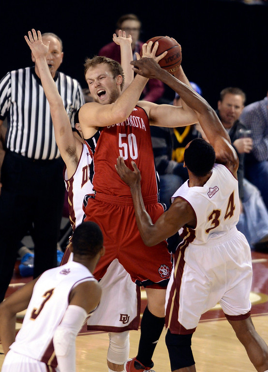 . DENVER, CO. - FEBRUARY 8, 2014: Denver forward Chris Udofia (34) was called for a foul as South Dakota center Trevor Gruis (50) moved to the basket in the first half. The University of Denver hosted South Dakota Saturday afternoon, February 8, 2014. Photo By Karl Gehring/The Denver Post