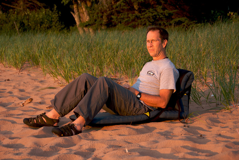 Tony enjoying a sunset at Little Sand Beach, the campground we stayed at before launching the boats the next morning.