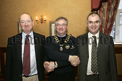 New members for Rotary Club, Neil Tate, (President Rotary Club) welcomes new members, Michael Mc Cann, (left), Raymond Mc Cormick, (left). 06W8N11