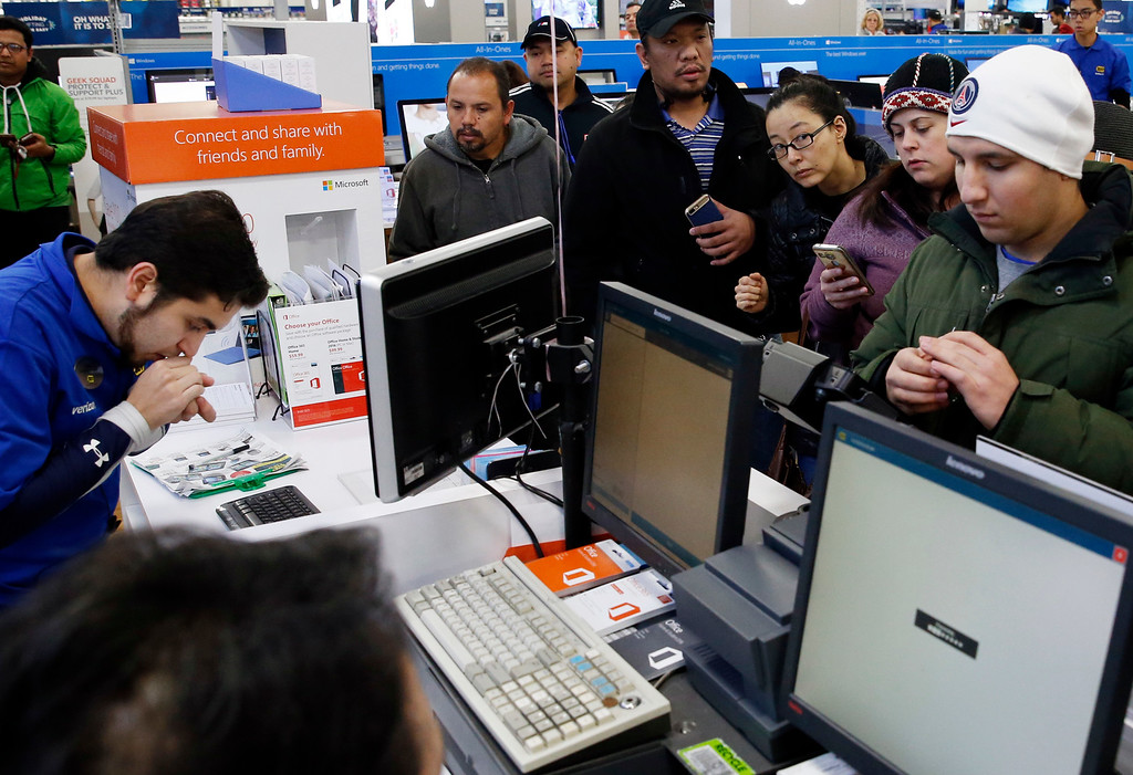 . Shoppers line up for purchases at a Best Buy store on Friday, Nov. 25, 2016, in Skokie, Ill. Shoppers were on the hunt for deals and were at the stores for entertainment Friday as malls opened for what is still one of the busiest days of the year, even as the start of the holiday season edges ever earlier.  (AP Photo/Nam Y. Huh)