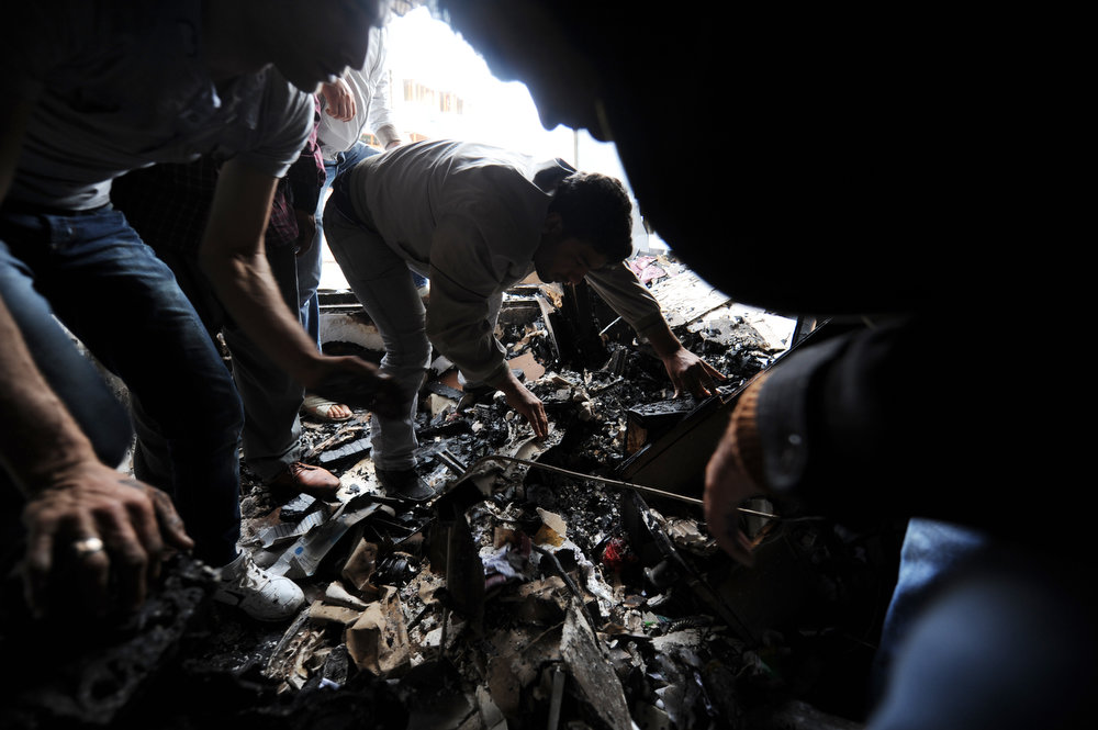 . Men sift through debris in a damaged building on May 12, 2013 on a street hit by a car bomb explosion which went off on May 11 in Reyhanli in Hatay, just a few kilometers from the main border crossing into Syria. Turkey was reeling from twin car bomb attacks which left at least 43 people dead in a town near the Syrian border, with Ankara blaming pro-Damascus groups and vowing to bring the perpetrators to justice.   BULENT KILIC/AFP/Getty Images