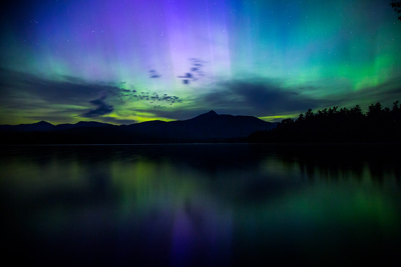 Aurora borealis over lake Chocorua, New Hampshire, USA