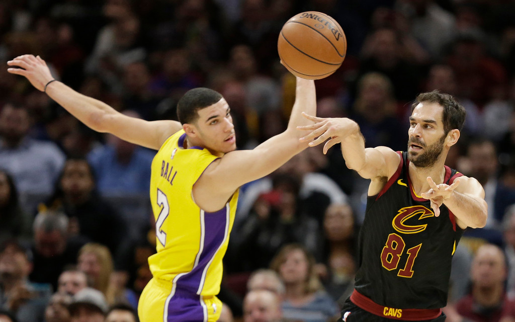 . Cleveland Cavaliers\' Jose Calderon (81), from Spain, passes over Los Angeles Lakers\' Lonzo Ball (2) in the second half of an NBA basketball game, Thursday, Dec. 14, 2017, in Cleveland. (AP Photo/Tony Dejak)