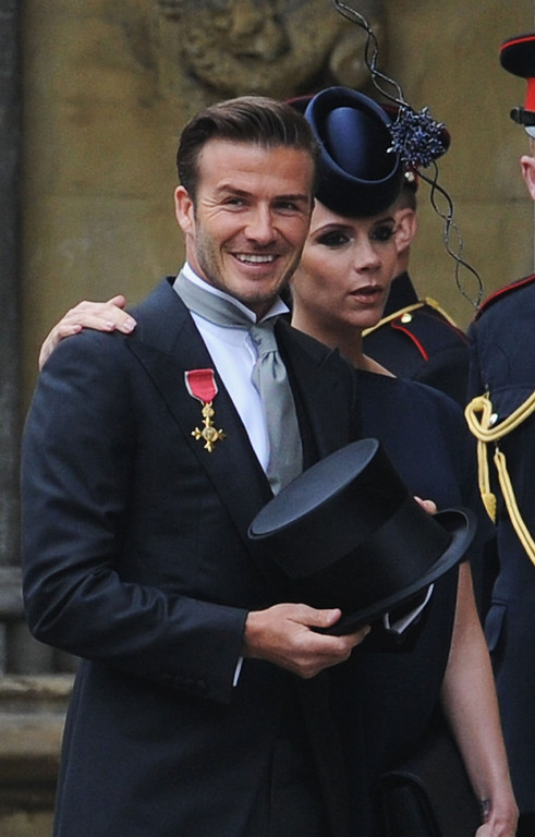 . David Beckham and Victoria Beckham arrive to attend the Royal Wedding of Prince William to Catherine Middleton at Westminster Abbey on April 29, 2011 in London, England. The marriage of the second in line to the British throne is to be led by the Archbishop of Canterbury and will be attended by 1900 guests, including foreign Royal family members and heads of state. Thousands of well-wishers from around the world have also flocked to London to witness the spectacle and pageantry of the Royal Wedding.  (Photo by Jasper Juinen-WPA Pool/Getty Images)