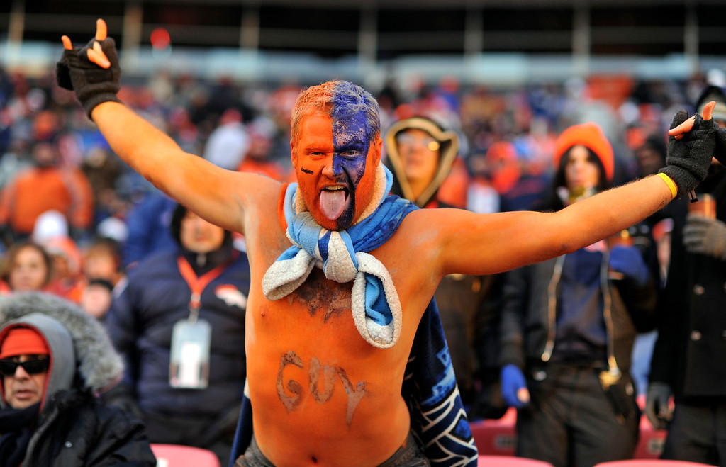 . DENVER, CO - DECEMBER 8: Broncos fan Chris Sutton of Pueblo, CO braves the cold shirtless during the third quarter.  The Denver Broncos vs. the Tennessee Titans at Sports Authority Field at Mile High in Denver on December 8, 2013. (Photo by Hyoung Chang/The Denver Post)