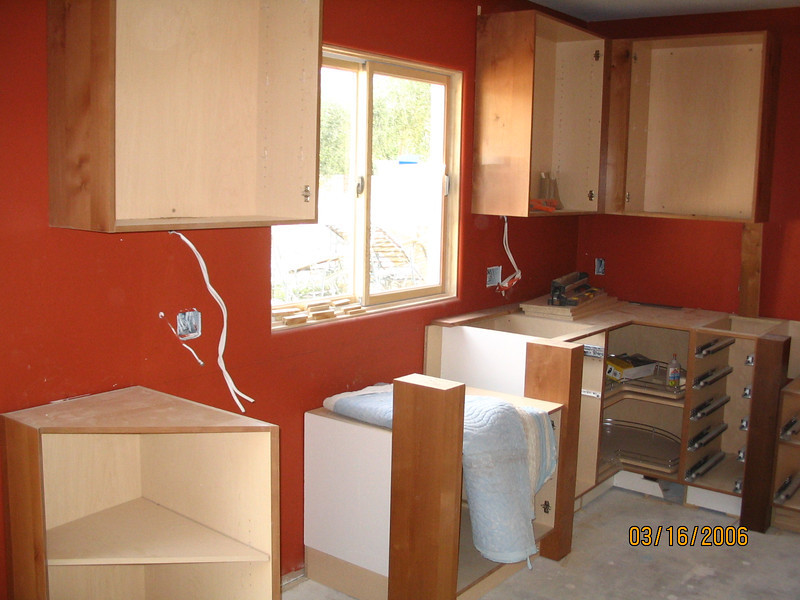Some cabinets have been hung, and the kitchen is really beginning to take shape.