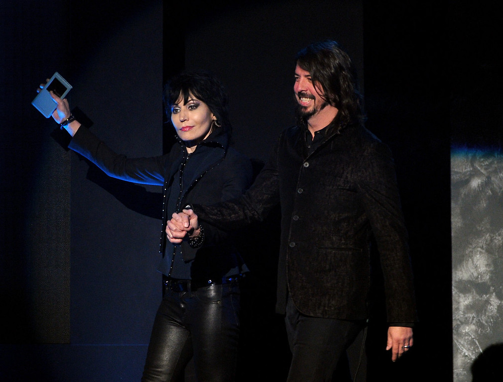 . Musicians Joan Jett and Dave Grohl speak onstage during the 2013 American Music Awards at Nokia Theatre L.A. Live on November 24, 2013 in Los Angeles, California.  (Photo by Kevin Winter/Getty Images)