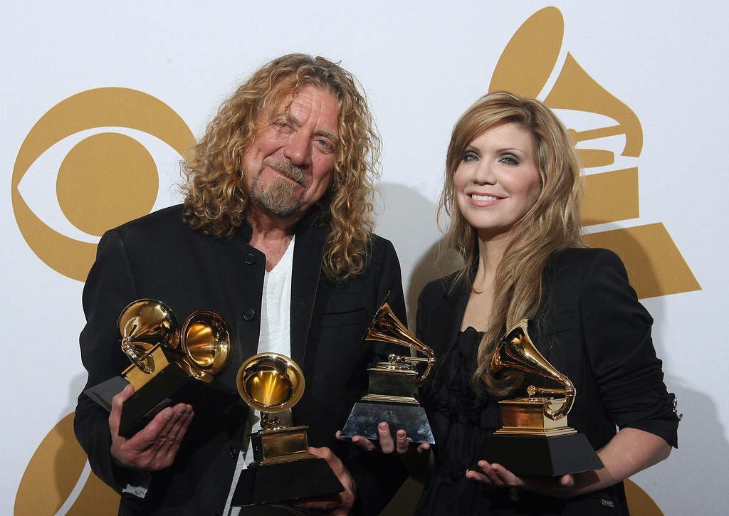 ". Former Led Zeppelin singer Robert Plant and bluegrass queen Alison Krauss hold their Grammy awards in the photo room during the 51st annual Grammy awards held at the Staples Center in Los Angeles, on February 8, 2009. Plant and Krauss scooped five awards, including the coveted album of the year honor and record of the year prize for work stemming from their acclaimed ""Raising Sand.\"" VALERIE MACON/AFP/Getty Images"