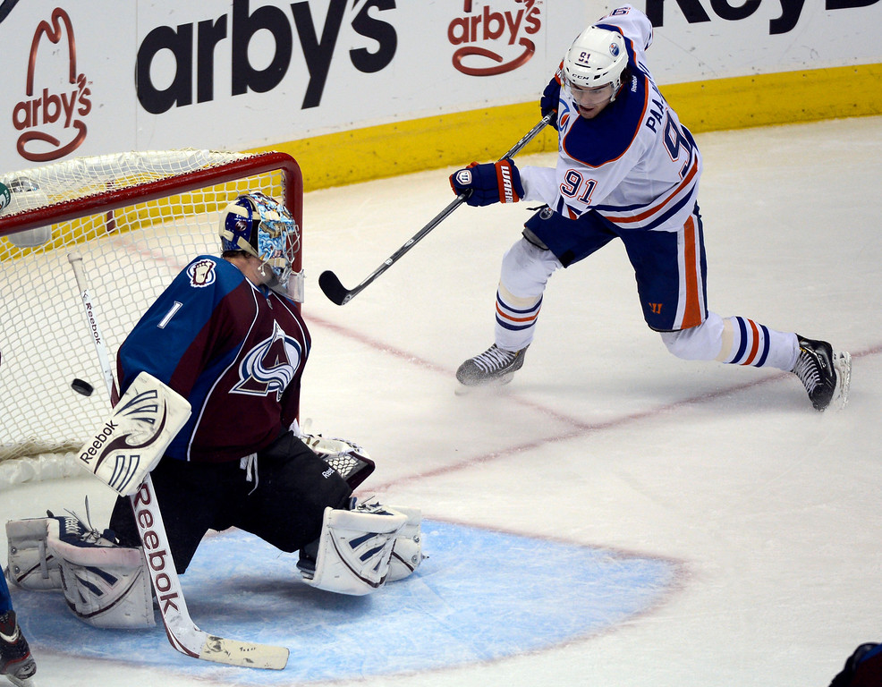 . Magnus Paajarvi (91) of the Edmonton Oilers slaps the puck out of mid air to score on Semyon Varlamov (1) of the Colorado Avalanche during the second period March 12, 2013 at Pepsi Center. (Photo By John Leyba/The Denver Post)