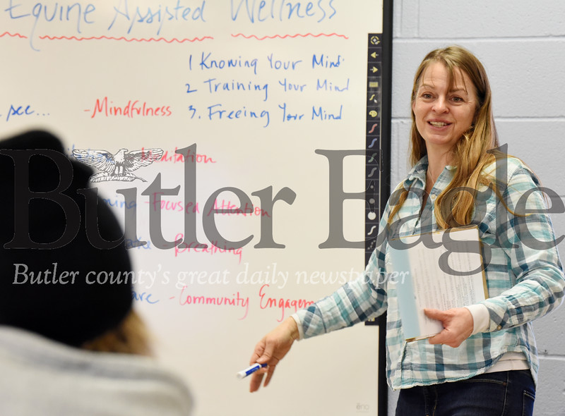 Harold Aughton/Butler Eagle: Julie Wahlenmayer, director of Glade Run Adventures, discusses the day's activities with participants taking part in the Equine Assisted Wellness Workshop, Sunday, February 2, 2020.