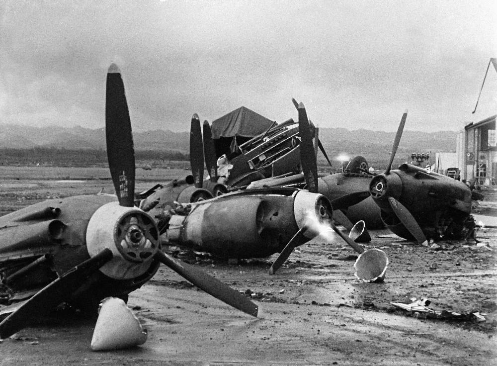 Description of . The shattered wreckage of American planes bombed by the Japanese in their attack on Pearl Harbor is strewn on Hickam Field, Dec. 7, 1941. (AP Photo)