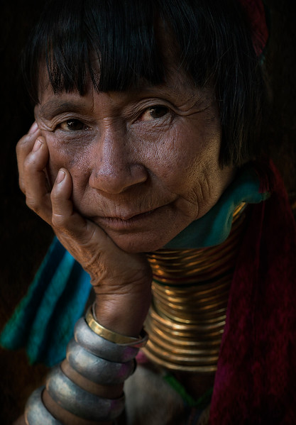 Portrait of a Kayan woman showing the traditional neck rings and bracelet.   Kayah State, Myanmar, 2017