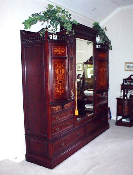 """Early 20th century English marquetry wardrobe. 7' 11"""" H, 8' 4"""" W, 2' 4"""" D. $2,000"""