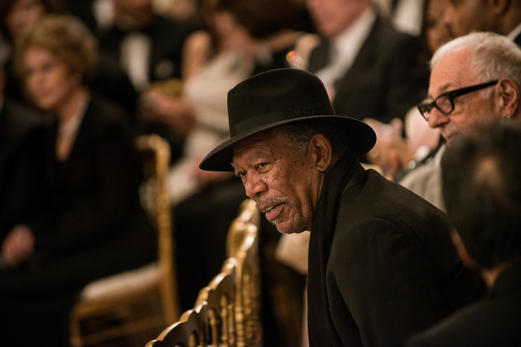 . Actor Morgan Freeman listens during an event in the East Room of the White House December 2, 2012 in Washington, DC. Obama and US First Lady Michelle Obama attended the event at the White House with the 2012 Kennedy Center Honorees before to celebrate their contribution to the arts before heading to the Kennedy Center for the honors program. BRENDAN SMIALOWSKI/AFP/Getty Images