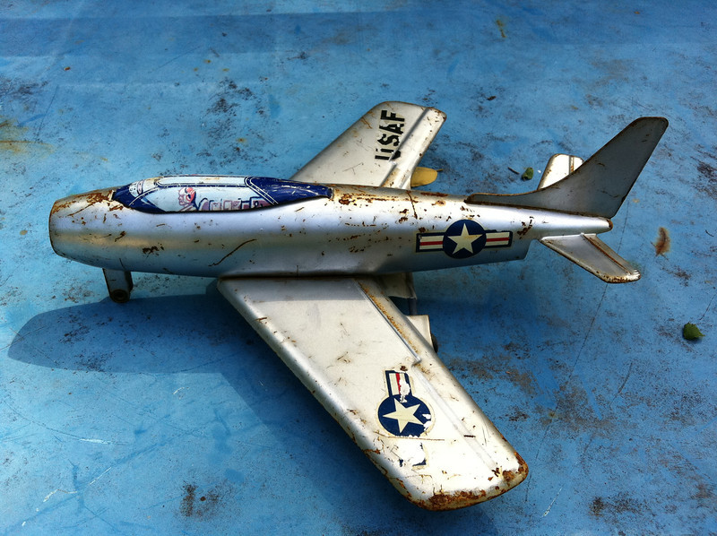 this is one of my favorite shots....plane....on a sky blue background...perfect....with some nice rust and shadows mixed in...