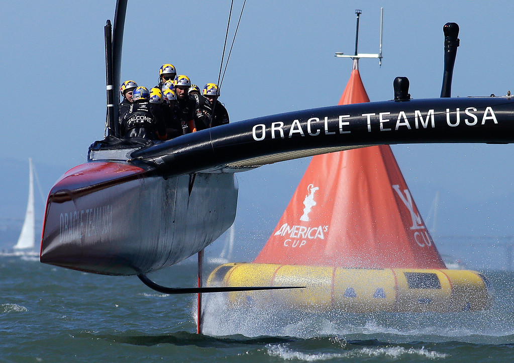 . Oracle Team USA crosses the finish line during the 18th race of the America\'s Cup sailing event against Emirates Team New Zealand on Tuesday, Sept. 24, 2013, in San Francisco.  (AP Photo/Ben Margot, File)