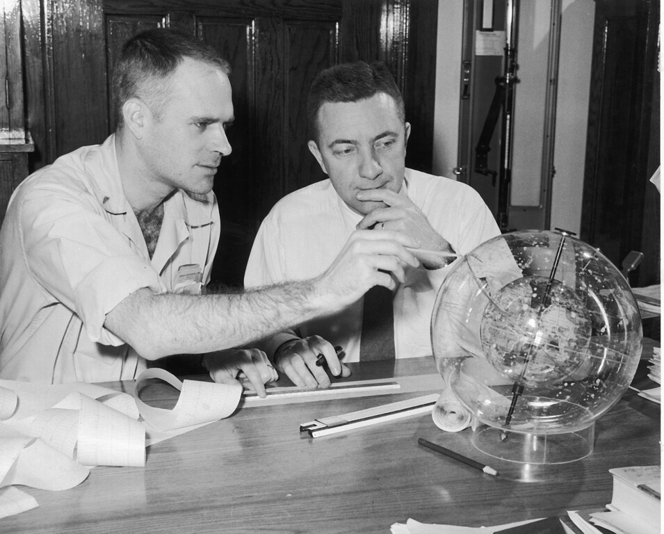 . Prof. Ernest Ray, left, and Dr. James Van Allen, State University of Iowa scientists, study the satellite Explorer orbit by use of a spatial globe around a plastic sphere representing the Earth, Feb. 4, 1958, in Iowa City.  (AP Photo)