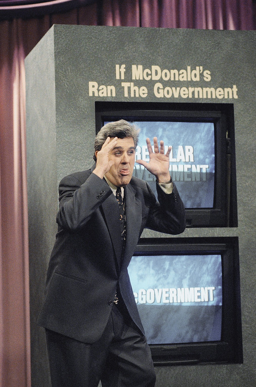 """. LENO SHOW 1993   \""""Tonight Show\"""" host Jay Leno gestures during a comedy sketch after a joke went wrong and said \""""I don\'t care if you don\'t laugh. I got the job. I guess we start renegotiating that contract tomorrow,\"""" during the taping of the show in Burbank, Calif., Jan 14, 1993. (AP Photo/Kevork Djansezian)"""
