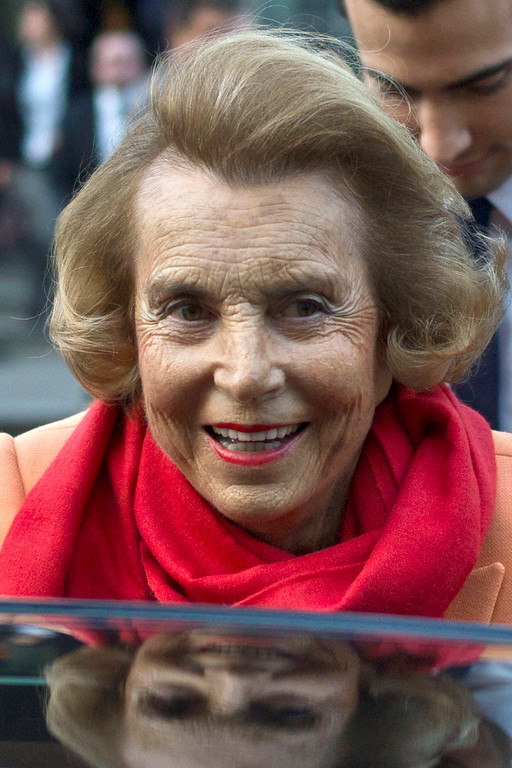 . FILE - In this March 29, 2012 file photo, L\'Oreal heiress Liliane Bettencourt leaves the L\'Oreal-UNESCO prize for the women in science, in Paris, France. L\'Oreal cosmetics heiress Liliane Bettencourt died Sept. 20 at the age of 94 at her home, her family announced. (AP Photo/Thibault Camus, File)
