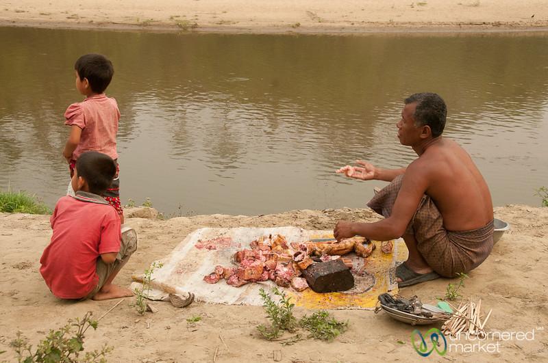 Chopping Up the Monitor Lizard on Market Day - Bandarban, Bangladesh
