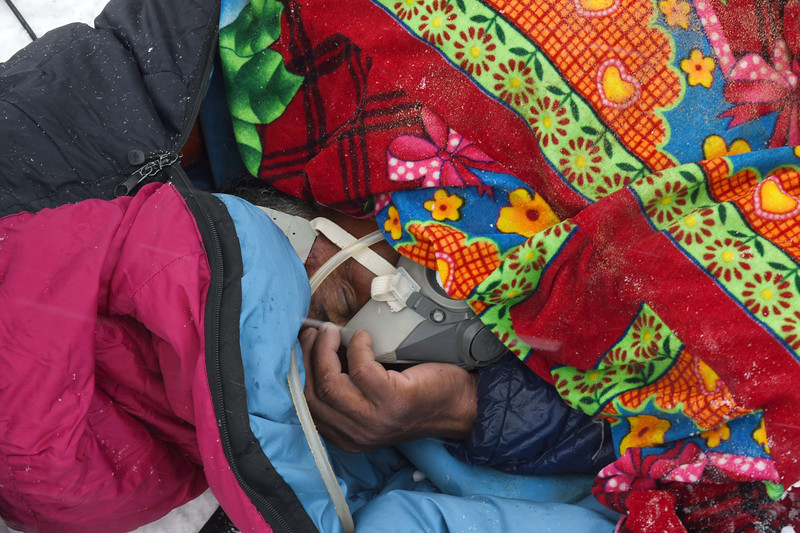 . In this photograph taken on April 25, 2015, Banja, a porter working for a trekking company holds on to a gas mask as he recovers after he was injured by snow and debris from an avalanche that flattened parts of Everest Base Camp.   Rescuers in Nepal are searching frantically for survivors of a huge quake on April 25, that killed nearly 2,000, digging through rubble in the devastated capital Kathmandu and airlifting victims of an avalanche at Everest base camp.   ROBERTO SCHMIDT/AFP/Getty Images
