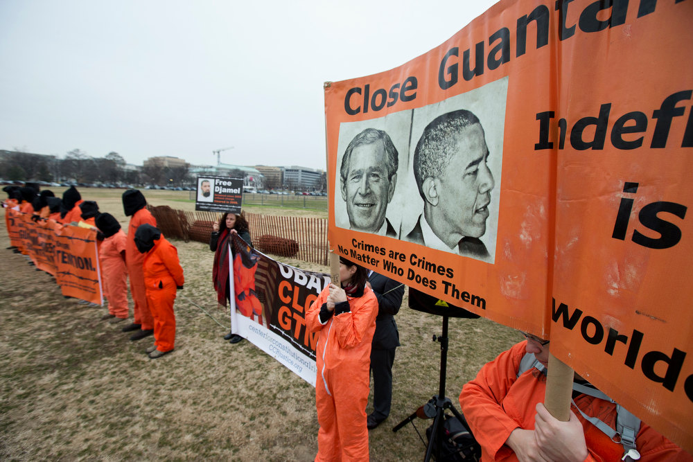 Description of . Human rights activists gather for a rally on the Ellipse, near the White House in Washington, Friday, Jan. 11, 2013. The rally marke the 11th anniversary of the first detainees being jailed at the U.S.-controlled detention facility in Guantanamo Bay, calling on President Barack Obama to close Guantanamo.   (AP Photo/Manuel Balce Ceneta)