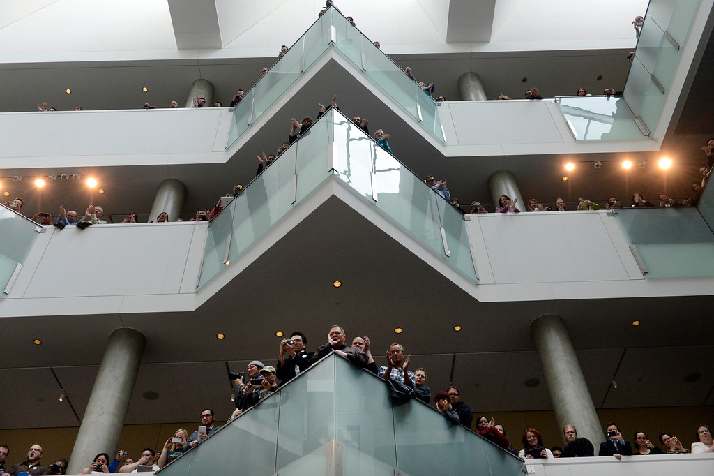 . DENVER, CO. - MARCH 21: A crowd filled the atrium at the History Colorado Center for a bill signing ceremony in  Denver, CO March 21, 2013. Gov. John Hickenlooper signed the Colorado Civil Union Act, making Colorado one of 18 states that offer recognition of same-sex couples, either through marriage or civil unions, according to the state\'s largest gay-rights group, One Colorado. The bill was sponsored by four openly gay lawmakers, Senators Pat Steadman and Lucia Guzman, Representative Sue Schafer, and Speaker Mark Ferrandino. (Photo By Craig F. Walker/The Denver Post)