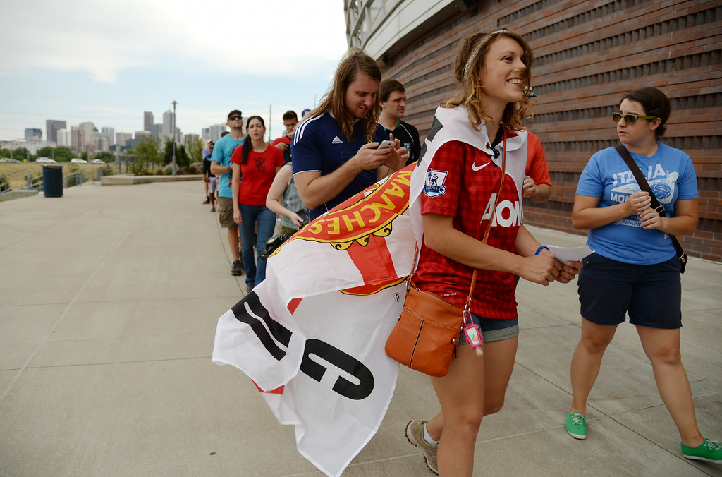 . Gabrielle Tinner of Denver, front, and soccer fans are in Sports Authority Field at Mile High for Manchester United vs. AS Roma Guinness International Champions Cup 2014, Denver, Colorado, July 26, 2014. (Photo by Hyoung Chang/The Denver Post)