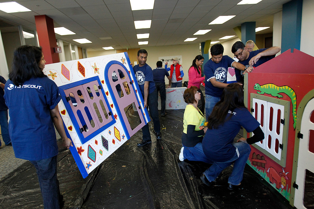 . Employees of NetScout Systems and volunteers from Habitat for Humanity construct two playhouses to be donated to families in the Blue Star Mom organization at the NetScout offices in San Jose, Calif. on Thursday, Feb. 21, 2013.   (LiPo Ching/Staff)