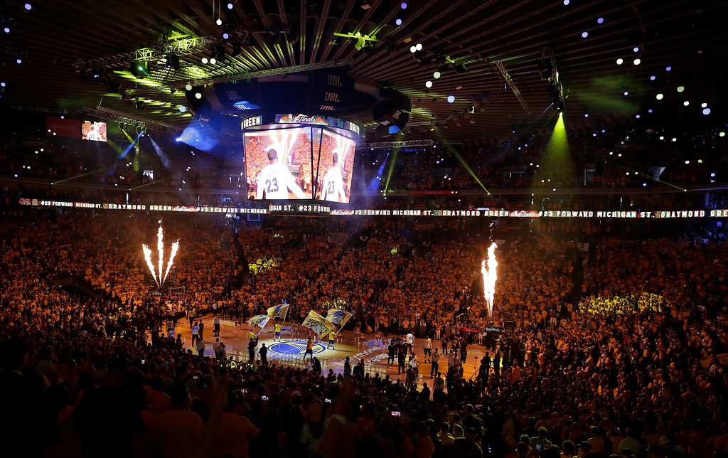 . Fans at Oracle Arena watch before Game 2 of basketball\'s NBA Finals between the Golden State Warriors and the Cleveland Cavaliers in Oakland, Calif., Sunday, June 4, 2017. (AP Photo/Marcio Jose Sanchez)