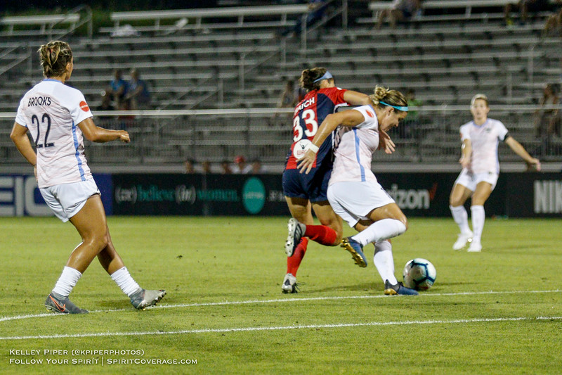 Washington Spirit forward Ashley Hatch (33) and Houston Dash midfielder Christine Nairn (10) fight for the ball at Maureen Hendricks Field in Boyds, MD, on July 20, 2019.