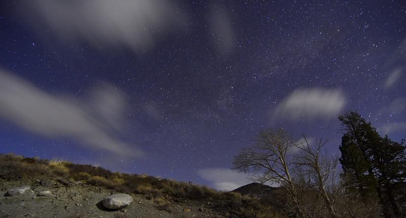 Clouds Race Across a Starry Night Sky