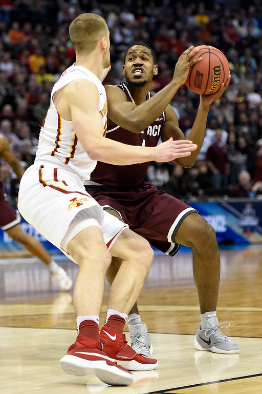 . Jalen Jackson (1) of the Arkansas Little Rock Trojans drives on Matt Thomas (21) of the Iowa State Cyclones during the first half of their second round NCAA Tournament game on Saturday, March 19, 2016. (Photo by AAron Ontiveroz/The Denver Post)