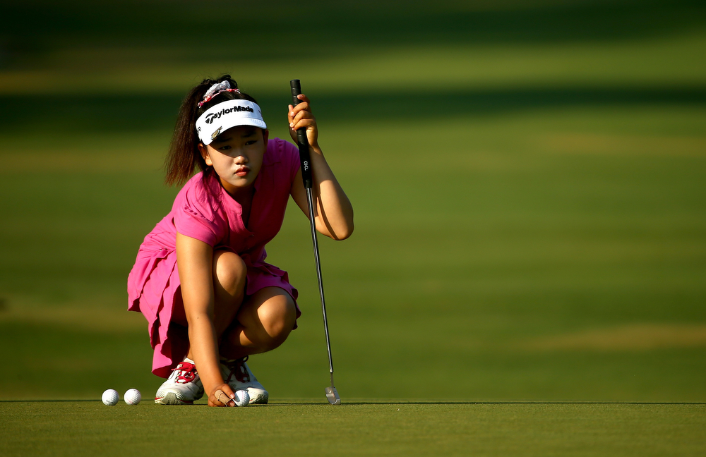 . Eleven-year old Amateur Lucy Li of the United States lines up a putt during a practice round prior to the start of the 69th U.S. Women\'s Open at Pinehurst Resort & Country Club, Course No. 2 on June 18, 2014 in Pinehurst, North Carolina.  (Photo by Streeter Lecka/Getty Images)