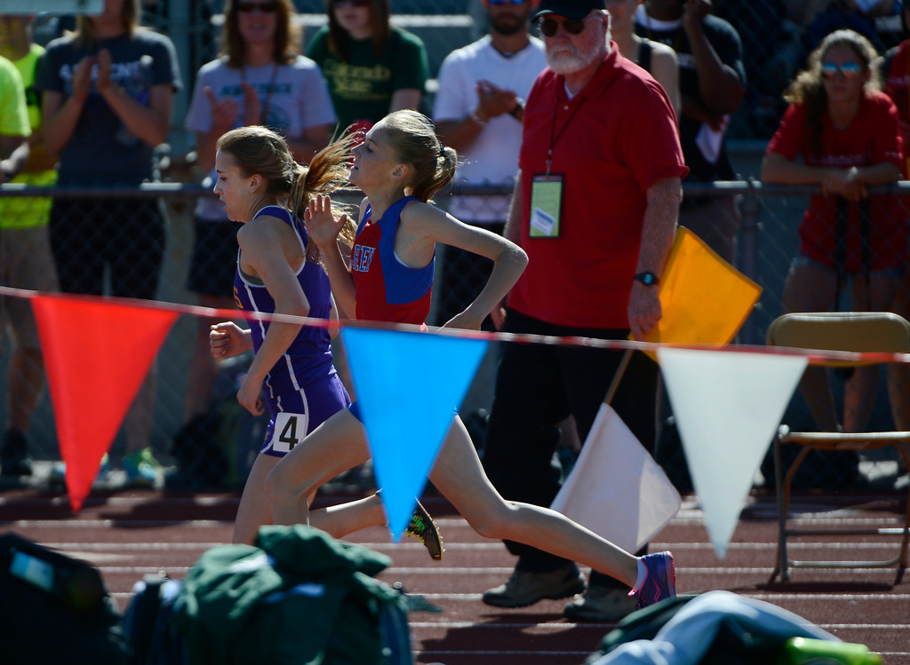 . LAKEWOOD, CO - MAY 16: Erin Hooker, Ft. Collins High School, left, overtakes Jordyn Colter, Cherry Creek High School, on turn two of the last lap and wins the girls 5A 3200 meter run final at the 2013 Colorado State Track and Field Championships at Jeffco Stadium May 16, 2013. (Photo By Andy Cross/The Denver Post)