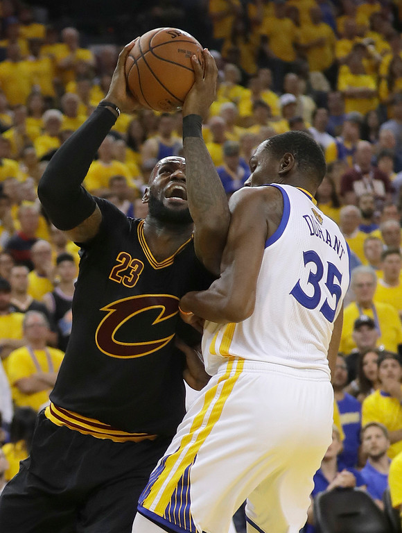 . Cleveland Cavaliers forward LeBron James (23) shoots against Golden State Warriors forward Kevin Durant (35) during the second half of Game 5 of basketball\'s NBA Finals in Oakland, Calif., Monday, June 12, 2017. (AP Photo/Marcio Jose Sanchez)