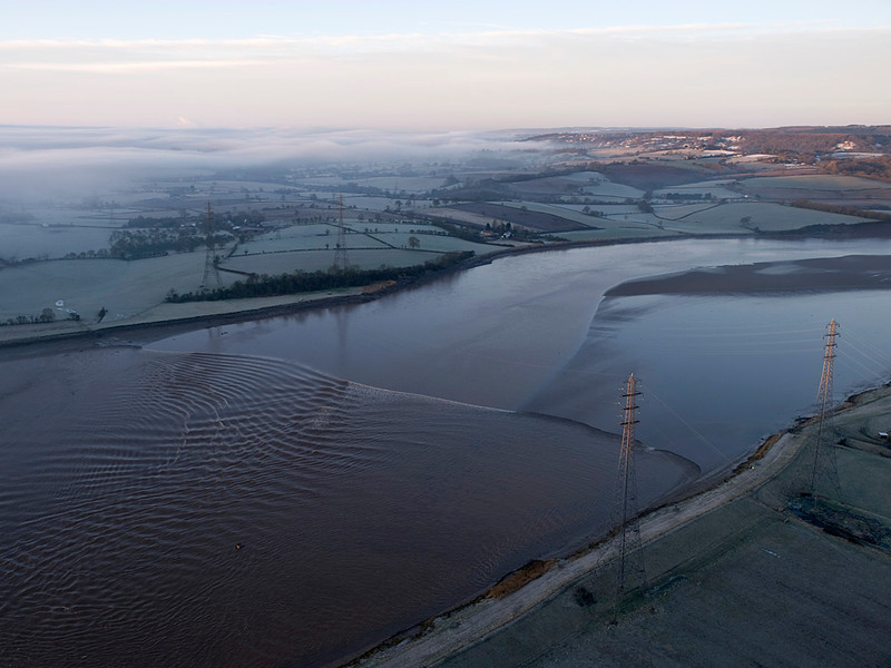 To witness the Severn Bore from the air is like nothing else. One can really appreciate the topography of the river as it channels the huge wave down the estuary and into the narrow sections upstream. The wave takes on many shapes and characteristics that just cannot be appreciated from the ground. It is a great vantage point to see the gravity waves. Most people perceive the bore to be a single wave. Check the images and dispel that myth. Olympus E3, 12-60mm SWD
