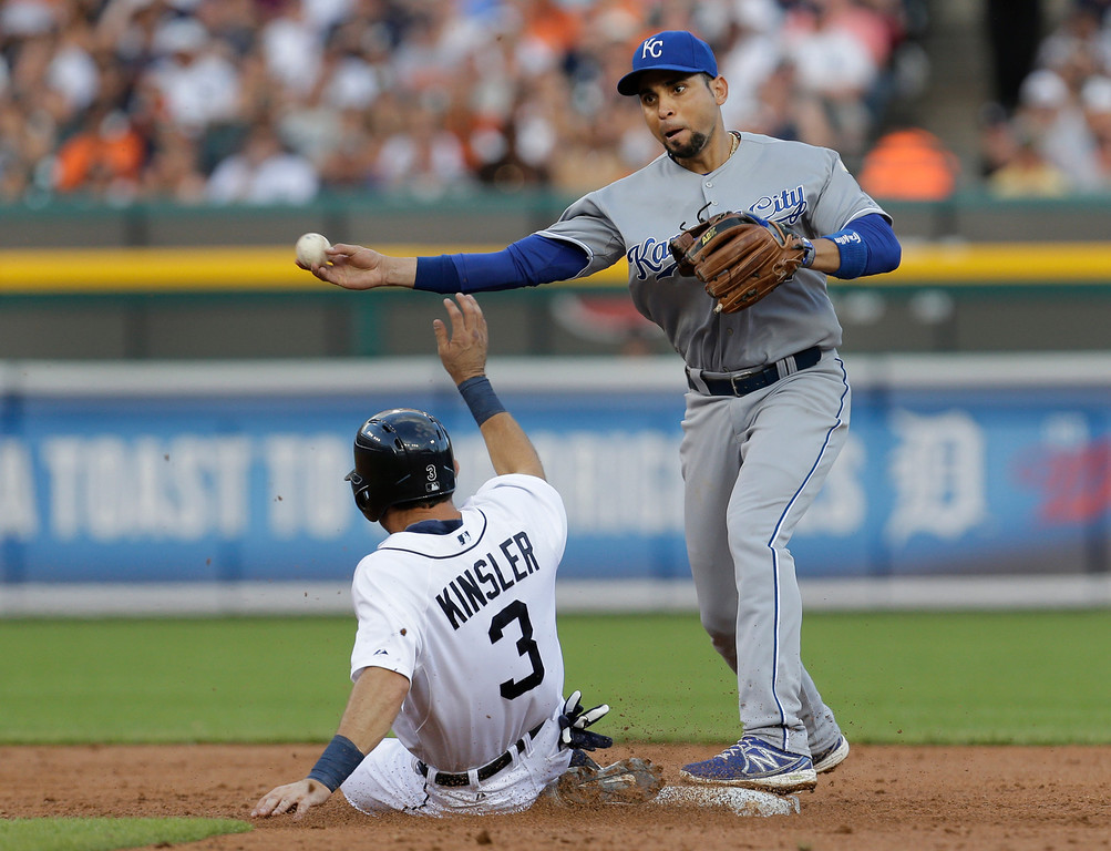 . Kansas City Royals second baseman Omar Infante, right, throws to first base to complete a double play as Detroit Tigers\' Ian Kinsler, left,  tries to break it up on a Miguel Cabrera ground ball in the third inning of a baseball game in Detroit, Monday, June 16, 2014.  (AP Photo/Paul Sancya)