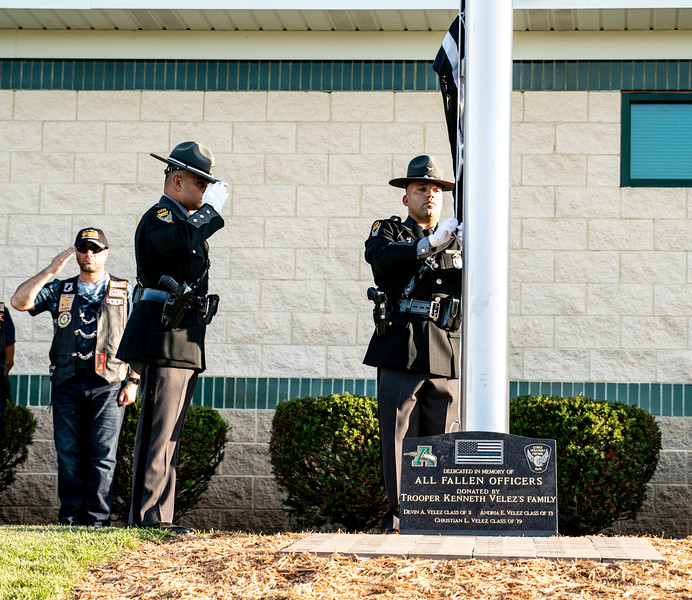 State Highway Patrol Honor Guard raise the Blue Line flag representing fallen officers.jpg